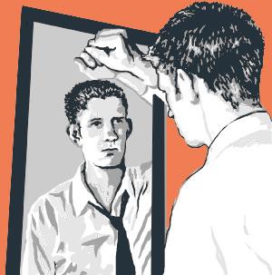 boy looking into mirror
