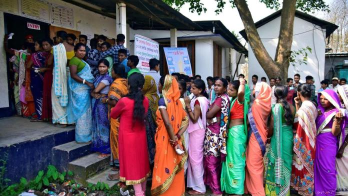 women queuing up outside a polling booth in India