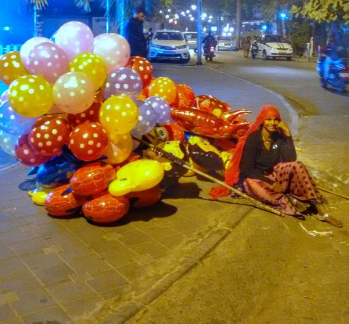Women at Leisure: A balloon seller takes a break after a long day of walking to different markets