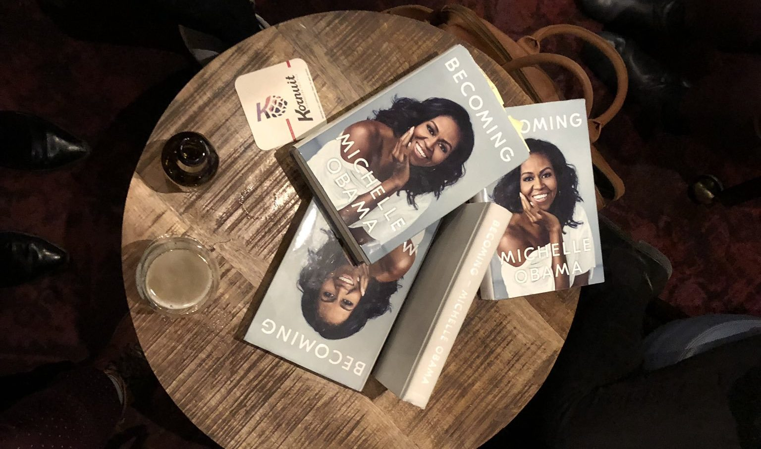 Picture of wooden table with a stack of Obama's 'Becoming'