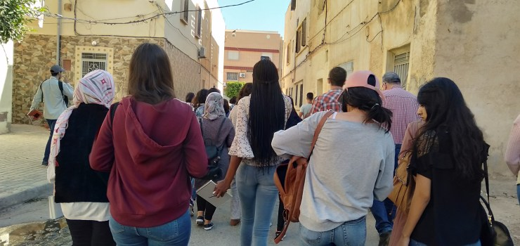 Orienta 7 visitors walking through the streets of the old city to explore the different venues of the event.