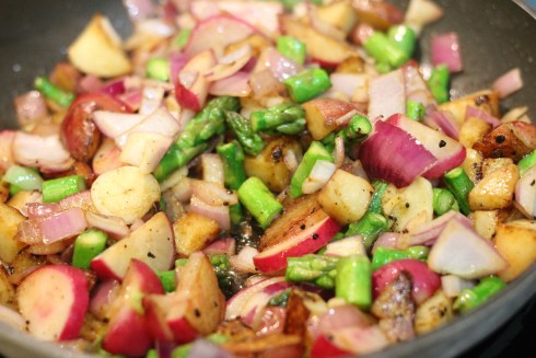 New potato, asparagus and radish hash cooking