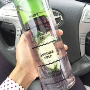 Green infusion water bottle with drink tracker