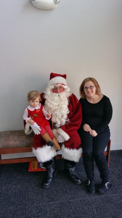 Rachel Harrison with Santa and daughter