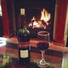 Red wine and a roaring fire at Silver Mist Guesthouse, Kaapsehoop