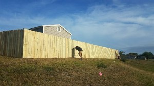 a man doing fence installation in El Paso