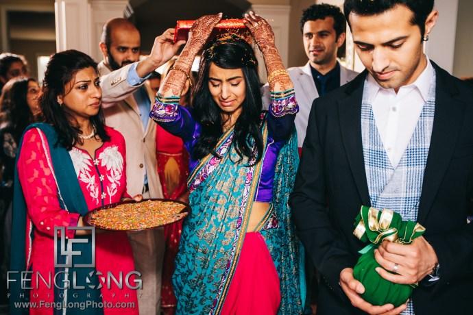 Indian bride crying during ruhksati