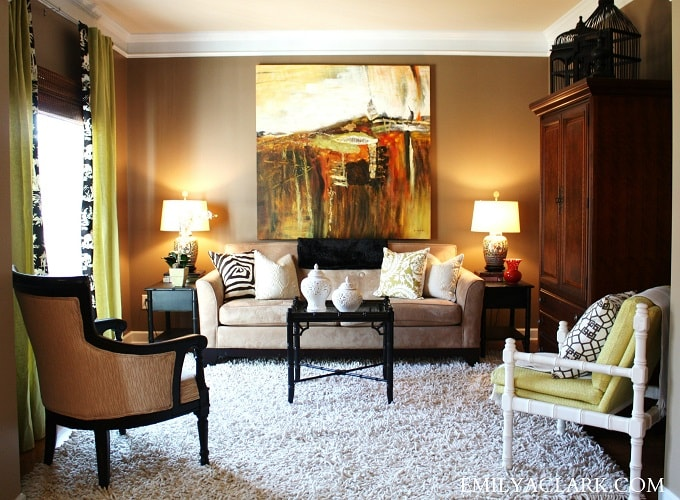 feng shui art for living room warm green colors 27 tips rules location design furniture hanging an artwork behind the sofa is not bad luck totally fine