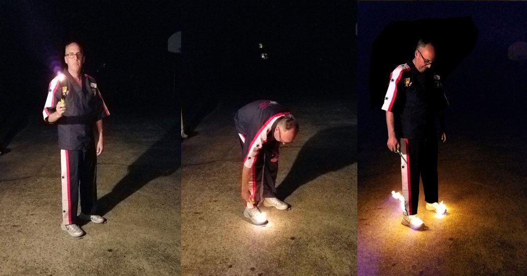 man burning his own shoes as he wears them