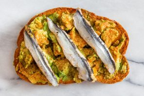 Anchovy fillets on avocado toast