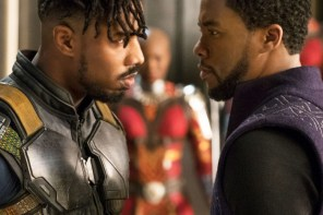 michael b jordan (killmonger) and chadwick boseman (black panther) glare angrily at each other