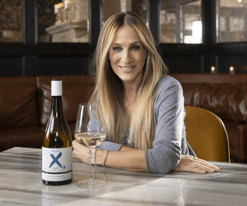 Sarah Jessica Parker with Invivo Wine on table top