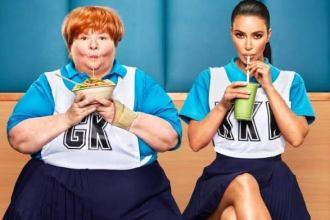 Kim Kardashian West sitting next to Magda Szubanski sipping on straws