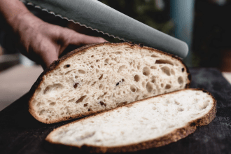 Close up of sliced sourdough bread with knife