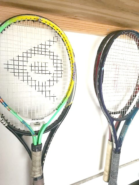Tennis racquet storage ideas to keep your racquets ready for play.