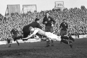 (L-R) Dynamo Moscow goalkeeper Alexei 'Tiger' Khomich makes a save as a Cardiff City forward attempts an unlikely shoulder charge
