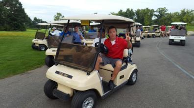 Andrew on golf cart