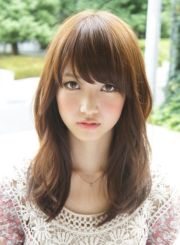 medium length with bangs hairstyle