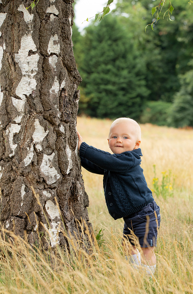 Little lad next to tree