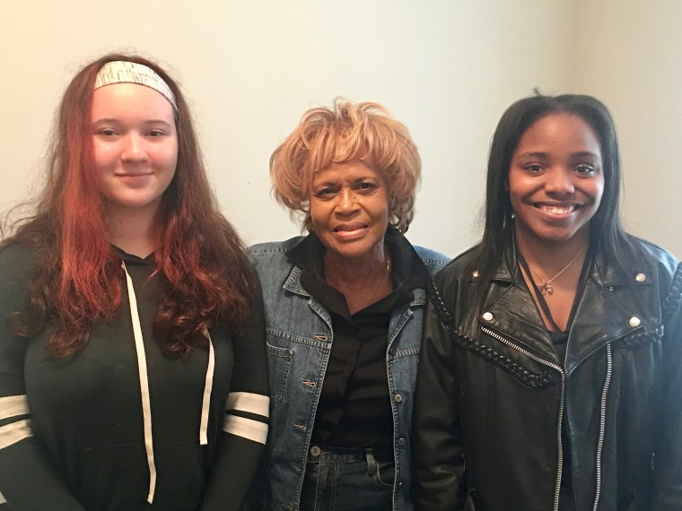 Dr. Mamie Smith Author becomes teacher with two of her thousands of students she has taught vocal music.