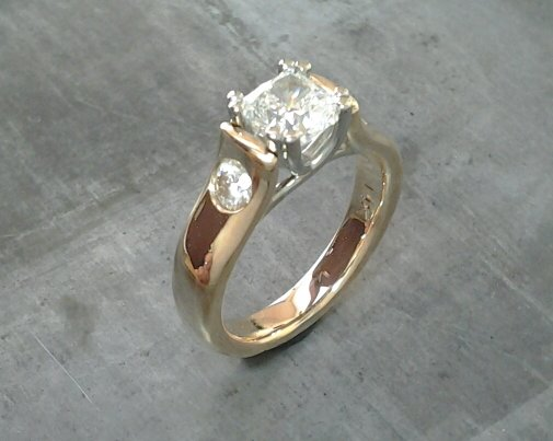 custom design 14k gold engagement ring with princess cut diamond and round cut accent diamonds