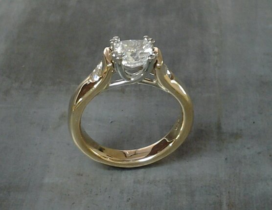 custom design 14k gold engagement ring with princess cut diamond and round cut accent diamonds side view