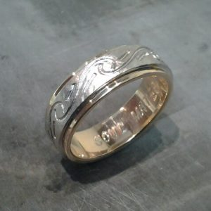 custom wedding band with yellow and white gold and swirl engraving side view