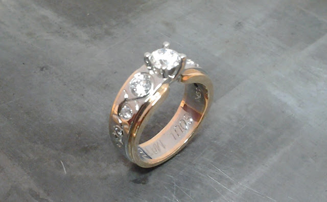 rose and white gold engagement ring with custom engraving and flush set diamond band