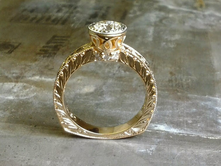 gold leaf filigree engagement ring with round diamond in bezel setting