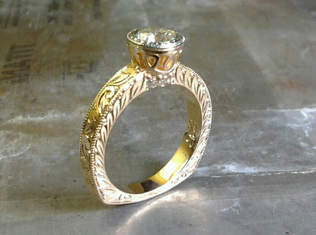 gold leaf filigree engagement ring with round diamond in bezel setting side view