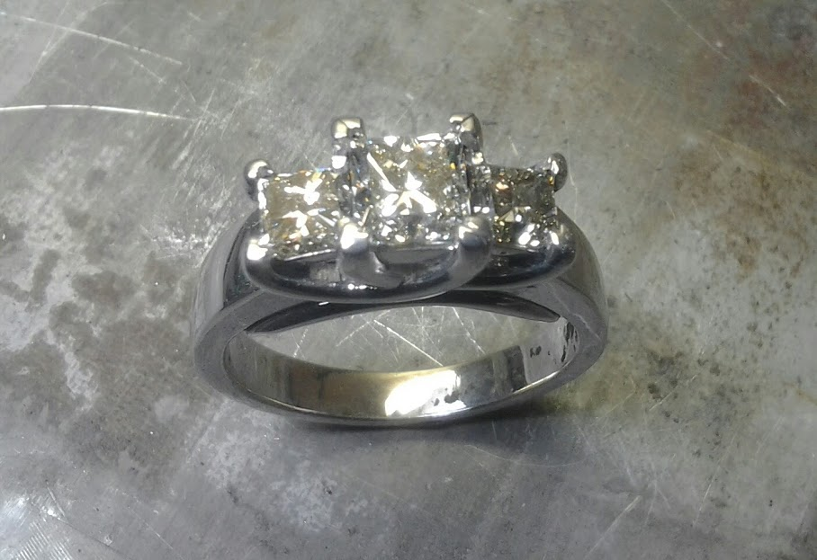 triple set diamonds in white gold band top view