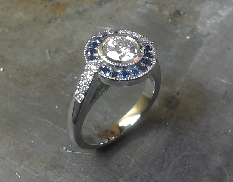 star wars inspired r2d2 white gold engagemnt ring with large round cut diamond and sapphire halo setting