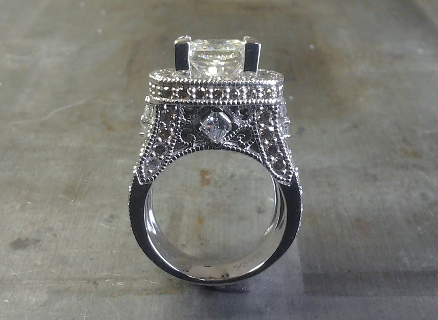 diamond encrusted engagement ring with large center stone