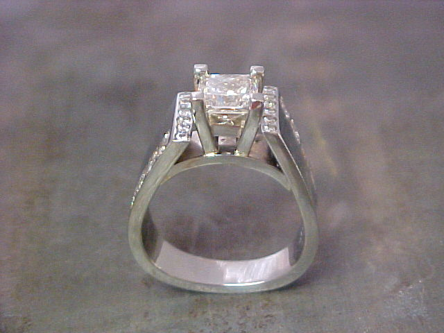 engagement ring with thick band and princess cut diamond