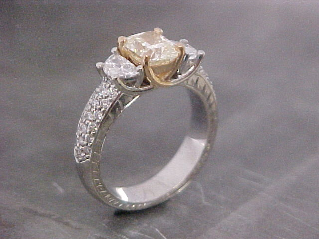 custom designed engagement ring with unique cut accent diamonds