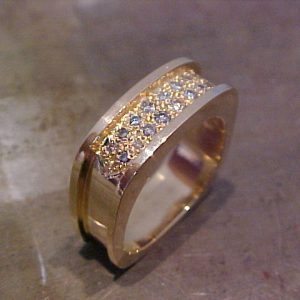 custom square shaped gold wedding band with diamond cluster and custom engraving