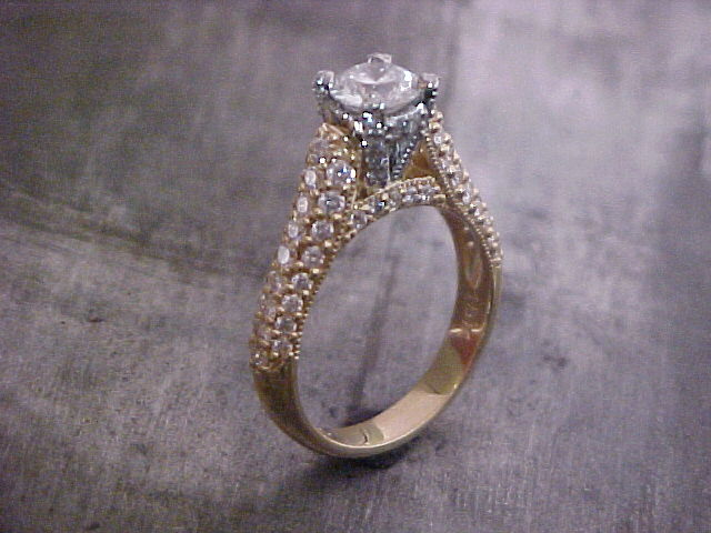 custom engagement ring with diamond encrusted band and custom engraving
