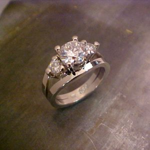 custom 14k white gold ring with triple diamond setting
