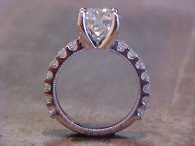 custom engagement ring with diamond band and large round diamond side view