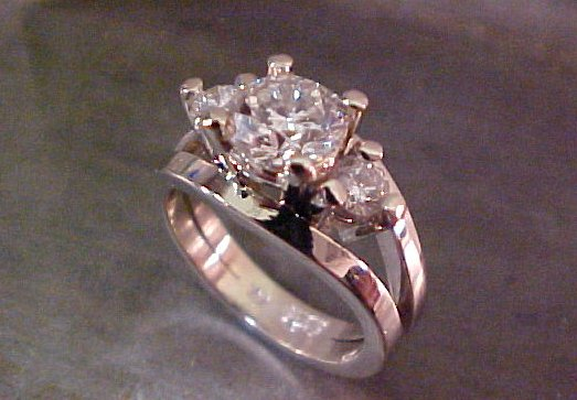 custom engagement ring with triple diamond setting by sean ferguson