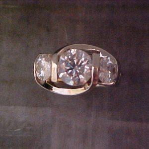 white gold custom ring with three large diamonds