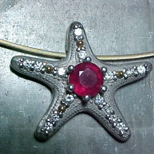 custom jewellery pendent with starfish design and rubies and diamonds