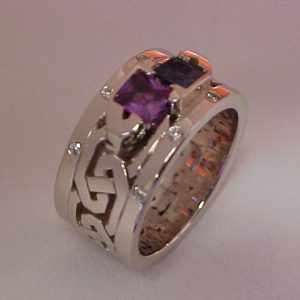 custom ring with blue and purple sapphires