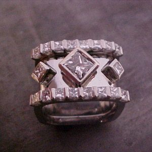 custom white gold ring with diamonds and square setting