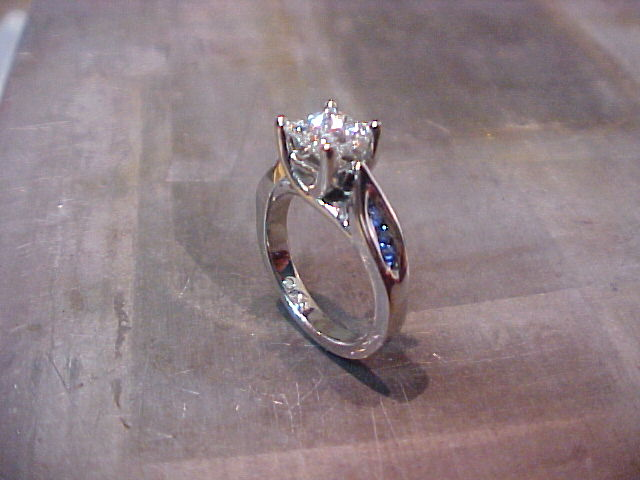 custom white gold solitaire engagement ring with side accent sapphires