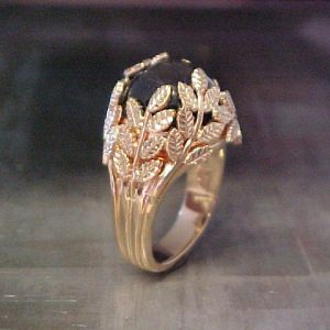 custom ring with leaf engraving holding center stone side view