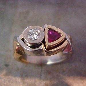 custom ring with ruby and diamond center stones
