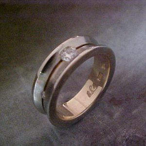 custom shape wedding ring with diamond accents