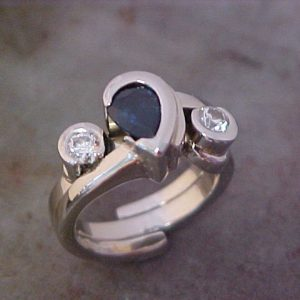 14k white gold custom ring with teardrop shaped sapphire center gem