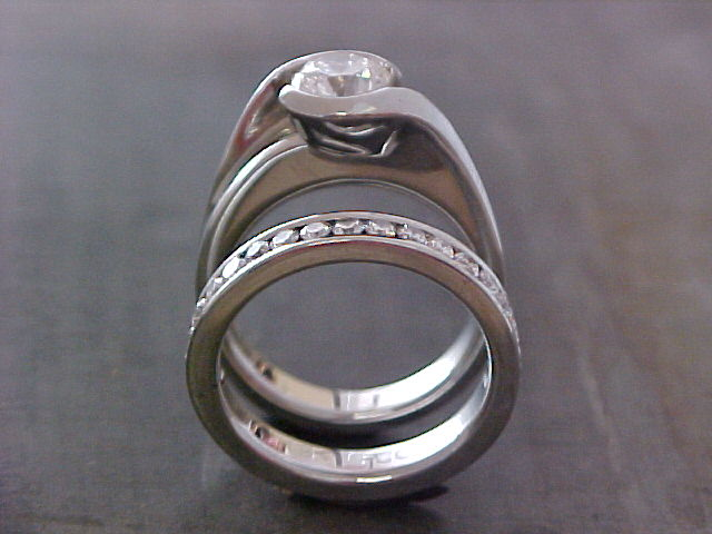 solitaire custom engagement ring and matching wedding band side view
